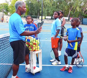 A group being taught the fundamentals of Tennis